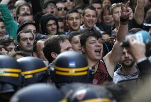 Demonstrators stand in front of riot police during Sarkozy's ill-fated campaign stop in Bayonne.