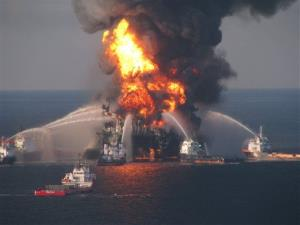 In this April 21, 2010, file photo provided by the U.S. Coast Guard, fire boat response crews spray water on the blazing remnants of BP's Deepwater Horizon offshore oil rig.