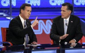Rick Santorum, left, makes a point as Mitt Romney listens during a Republican presidential debate Wednesday, Feb. 22, 2012, in Mesa, Ariz.