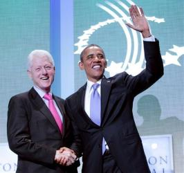President Obama and former President Bill Clinton shake hands at the Clinton Global Initiative in New York last year.