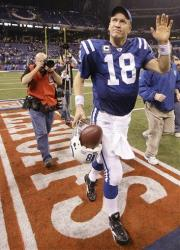 In this Jan. 16, 2010, photo, Indianapolis Colts quarterback Peyton Manning waves as he walks off the field after the NFL divisional football playoff game against the Baltimore Ravens in Indianapolis.
