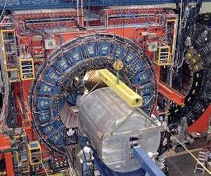 In this 2000 photo, workmen install a tracking chamber that will record particles emerging from the collision of protons and anti-protons at Fermi National Accelerator Laboratory in Batavia, Ill.