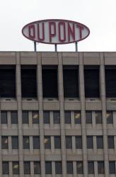 A DuPont sign is shown at the company's world headquarters April 12, 2004 in Wilmington, Delaware.