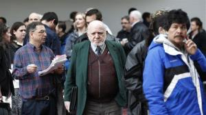 Job seekers stand in line during the Career Expo job fair Wednesday, March 7, 2012, in Portland, Ore.