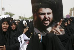 Iraqi women a poster of Muqtada al-Sadr. He thinks emo youths are a plague on society but says they should be dealt with only by legal means.