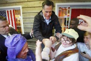 Birthday boy Mitt Romney greets supporters at the Whistle Stop Cafe in Mobile, Alabama yesterday.