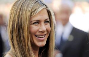 Actress Jennifer Aniston smiles after a ceremony to award her a star on the Hollywood Walk of Fame in Los Angeles, Wednesday, Feb. 23, 2012.