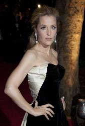 Actress Gillian Anderson arrives on the red carpet for the BFI 2011 London Film Festival Awards at St Luke's in east London, Wednesday, Oct. 26, 2011.