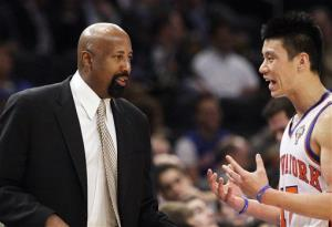 New York Knicks' Jeremy Lin, right, talks to interim head coach Mike Woodson, during the first half of a game against the Portland Trail Blazers.