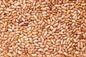 A Colorado man was killed after being buried by a 20-foot mound of pinto beans.