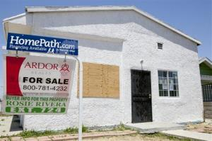A financing available by Fannie Mae sign is posted on a foreclosed property offered for sale Tuesday, May 31, 2011, in the Los Angeles.
