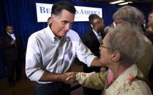 Republican presidential candidate former Massachusetts Gov. Mitt Romney greets people during a campaign stop Sunday, March 18, 2012 in Moline, Ill.