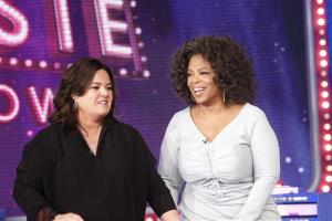 In this Oct. 10, 2011 file image released by Harpo, Inc., Oprah Winfrey, right, is shown with host Rosie O'Donnell during the debut of The Rosie Show, in Chicago.
