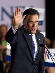 Mitt Romney waves to the crowd during a victory rally in Schaumburg, Illinois last night.