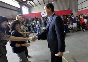 Rick Santorum greets supporters before speaking at Superior Energy in Harvey, Louisiana.