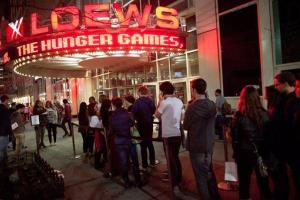 Fans line up to see the midnight shows of The Hunger Games in NYC.