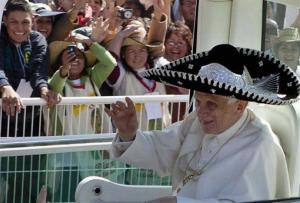 Pope Benedict XVI waves from the popemobile wearing a Mexican sombrero as he arrives to give a Mass in Bicentennial Park near Silao, Mexico, Sunday March 25, 2012.