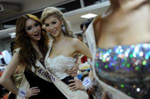 Canada's Jenna Talackova (right) poses  in an earlier beauty contest for the Miss International Queen 2010 pageant in Thailand.