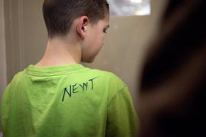 A young boy walks away after having his shirt signed by Newt Gingrich during a campaign stop in Hockessin, Del., Monday, March 26, 2012. Wonder how much that cost him?