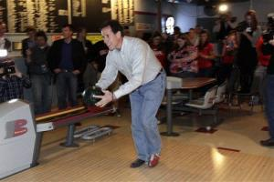 Santorum bowls during a campaign stop in La Crosse, Wisconsin, yesterday.