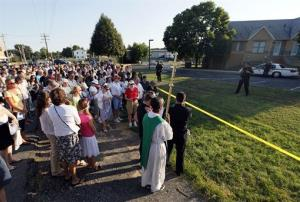 Anti-abortion participants pray outside an abortion clinic in Germantown, Md.