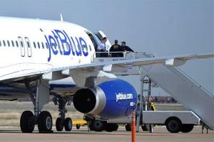 Authorities board JetBlue flight 191 after its emergency landing in Amarillo next week.