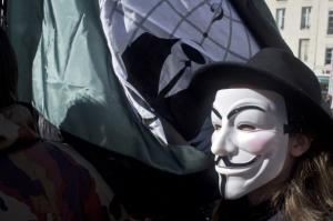 A protester wearing Anonymous Guy Fawkes mask takes part in a demonstration in France.