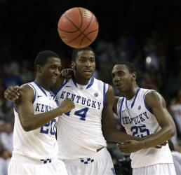 Kentucky guard Doron Lamb (20), forward Michael Kidd-Gilchrist (14), and guard Marquis Teague (25) celebrate during the second half.
