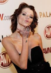 Adult film actress Joslyn James blows a kiss. She's in the sequel to an earlier porn film addressing Tiger Woods' sexcapades.