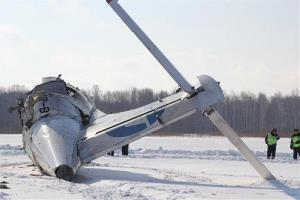 Russian police officers guard the site of the ATR-72 plane crash outside Tyumen.