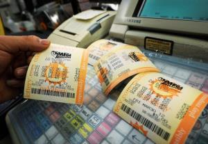 Mega Millions lottery tickets sit on a register at Liquorland on March 30, 2012 in Covina, California.