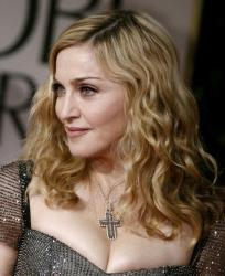 In this Jan. 15, 2012 file photo, Madonna arrives at the 69th Annual Golden Globe Awards in Los Angeles.