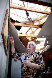 Patricia Daugherty searches for her belongings after her Arlington home was destroyed by a tornado.