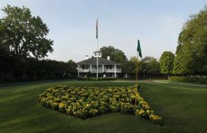 The sun rises over the Augusta National Golf Club house before practice rounds for the Masters golf tournament Wednesday in Augusta, Ga.
