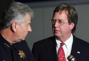 Tulsa Mayor Dewey Bartlett, right, chats with Tulsa Chief of Police Chuck Jordan during a news conference at the Tulsa Police Department, Saturday, April 7, 2012 in downtown Tulsa, Okla.