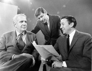 This 1968 photo released by CBS shows 60 Minutes correspondents Harry Reasoner, left, and Mike Wallace, right, with creator and producer Don Hewitt on the set in New York.