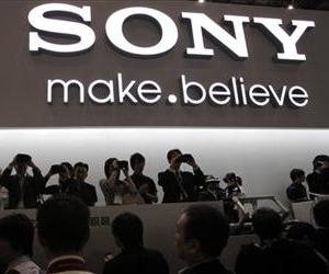 Visitors try out head-mounted 3-D viewers at the booth of Japanese entertainment and electronics giant Sony Corp, in this Oct. 4, 2011 file photo.