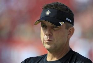 This Oct. 16, 2011 file photo shows New Orleans Saints head coach Sean Payton watching his team warm up for an NFL game against the Tampa Bay Buccaneers, in Tampa, Fla.