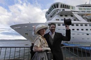 Passengers pose for pictures in period costume as they disembark on the MS Balmoral.