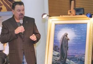 In this Sept. 15, 2006 file photo, artist Thomas Kinkade unveils his painting, Prayer For Peace, at the opening of the exhibit From Abraham to Jesus, in Atlanta.