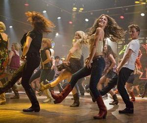 In this image released by Paramount Pictures, Julianne Hough, center, and Kenny Wormald are shown in a scene from Footloose.