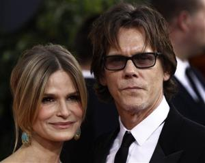 Kyra Sedgwick and her husband Kevin Bacon, right, arrive for the Golden Globe Awards Sunday, Jan. 16, 2011, in Beverly Hills, Calif.