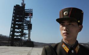 A North Korean soldier stands guard in front of an Unha-3 rocket on April 8.