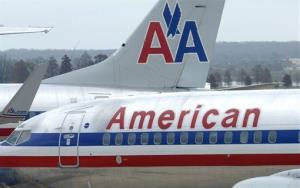 Paying customers were bumped out of first class to make room for American executives, David claims.