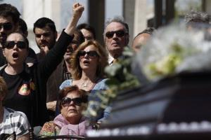Mourners chant slogans in front of the coffin containing the body of 77-year-old Dimitris Christoulas, who killed himself in Athens.