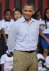 President Barack Obama winks as he attend a land titling event for Afro-Colombian communities with pop star Shakira and Colombia's President Juan Manuel Santos in Cartagena, Colombia, April 15, 2012.