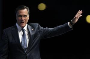 Mitt Romney waves after speaking at the National Rifle Association convention in St. Louis, Friday, April 13, 2012.