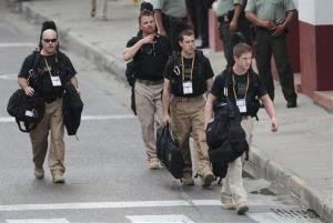 US Secret Service agents (not necessarily the ones involved in the scandal) walk around the Convention Center in Cartagena, prior to the opening of the Summit of the Americas.
