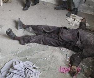 The body of a militant lies on the ground after a gun battle in Kabul, Afghanistan, in this file photo. This is not one of the photos in question.