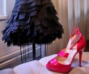 A dress by fashion designer Carmen Marc Valvo and hot-pink Christian Louboutin heels made for the Barbie fashion show are seen Friday, Feb. 6, 2009, in New York.